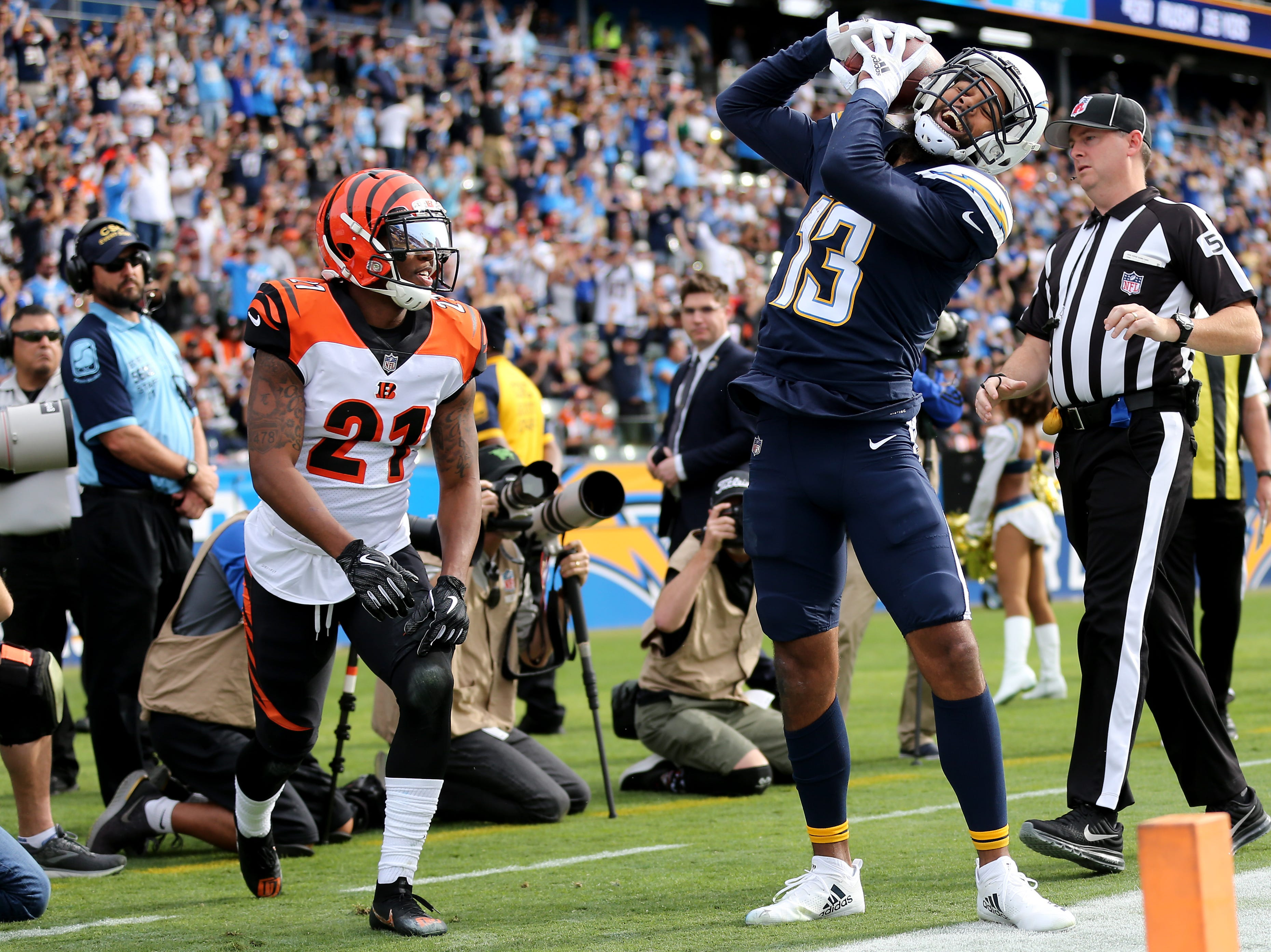 Los Angeles Chargers wide receiver Keenan Allen (13) celebrates a touchdown pass as Cincinnati Bengals defensive back Darqueze Dennard (21) watches in the first quarter of a Week 14 NFL football game, Sunday, Dec. 9, 2018, at StubHub Center in Carson, California.