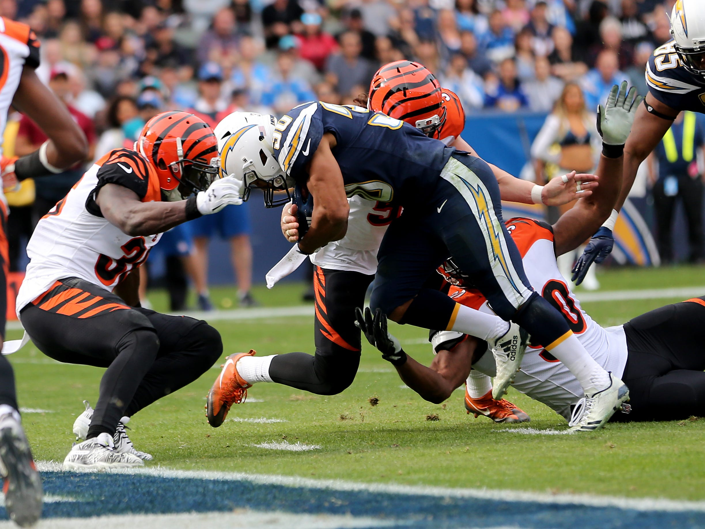 Los Angeles Chargers running back Austin Ekeler (30) scores a touchdown in the second quarter of a Week 14 NFL football game against the Cincinnati Bengals, Sunday, Dec. 9, 2018, at StubHub Center in Carson, California.