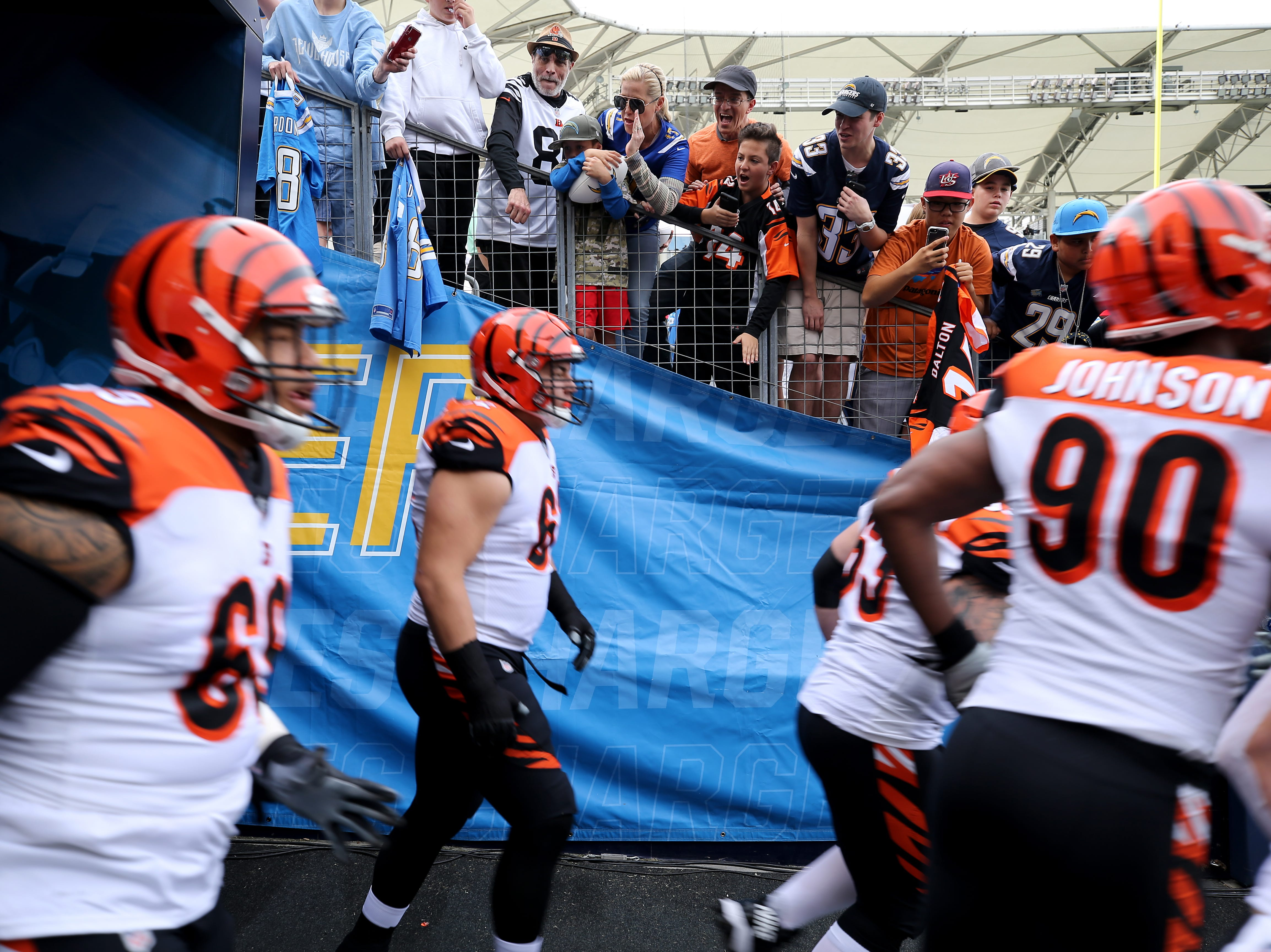 The Cincinnati Bengals offense is greater by fans as they take the field for warmups before a Week 14 NFL football game against the Los Angeles Chargers, Sunday, Dec. 9, 2018, at StubHub Center in Carson, California.