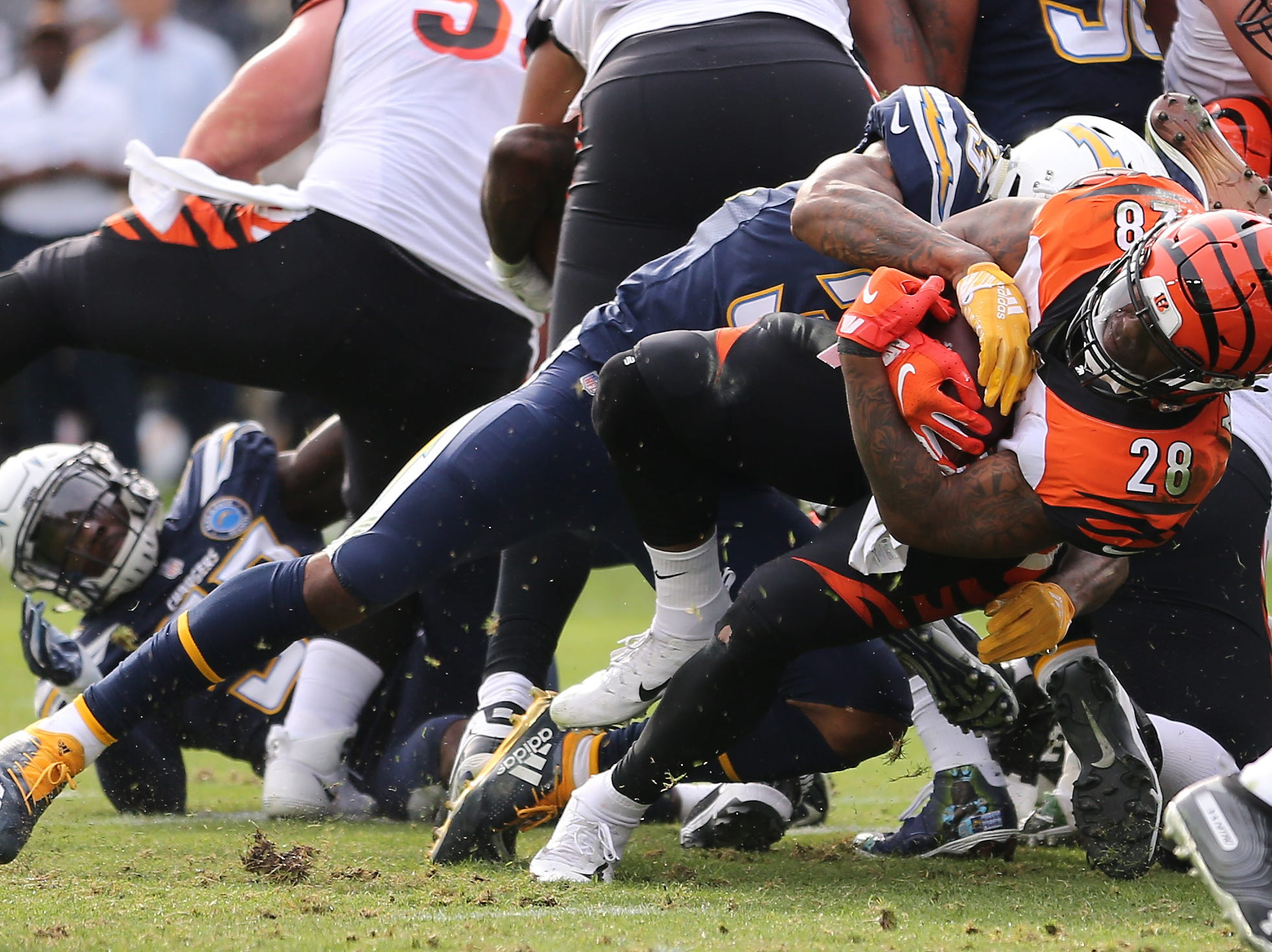 Cincinnati Bengals running back Joe Mixon (28) leans for end zone on a carry in the second quarter of a Week 14 NFL football game against the Los Angeles Chargers, Sunday, Dec. 9, 2018, at StubHub Center in Carson, California.