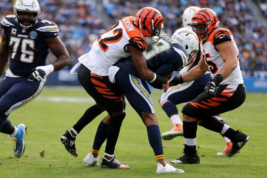 Cincinnati Bengals cornerback William Jackson (22) tackles Los Angeles Chargers wide receiver Keenan Allen (13) for a loss in the second quarter of a Week 14 NFL football game, Sunday, Dec. 9, 2018, at StubHub Center in Carson, California.