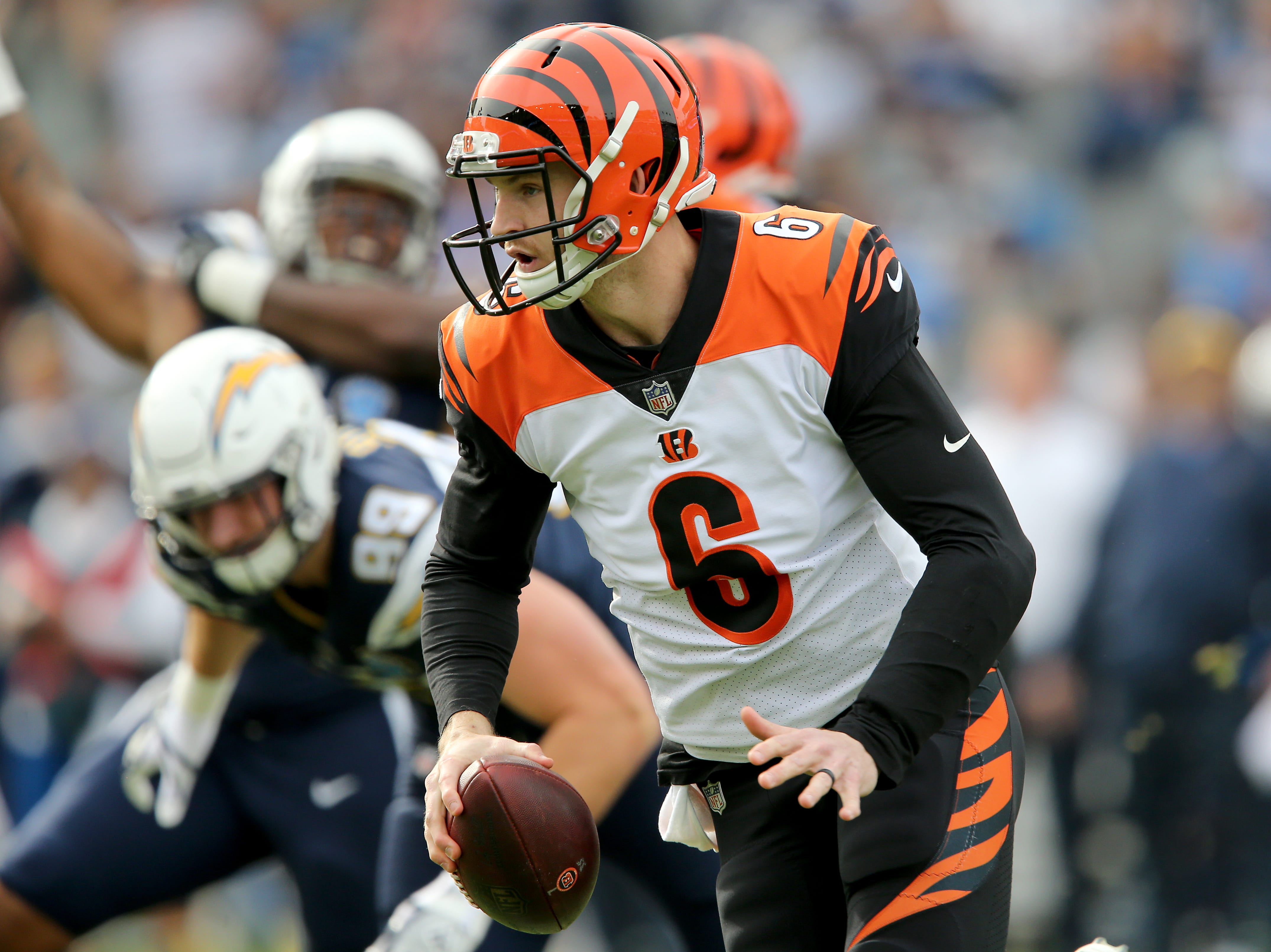 Cincinnati Bengals quarterback Jeff Driskel (6) runs out of the pocket in the first quarter of a Week 14 NFL football game against the Los Angeles Chargers, Sunday, Dec. 9, 2018, at StubHub Center in Carson, California.