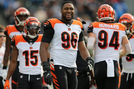 Cincinnati Bengals defensive end Carlos Dunlap (96), center, smiles as the offense runs off the field in the second quarter of a Week 14 NFL football game against the Los Angeles Chargers, Sunday, Dec. 9, 2018, at StubHub Center in Carson, California.
