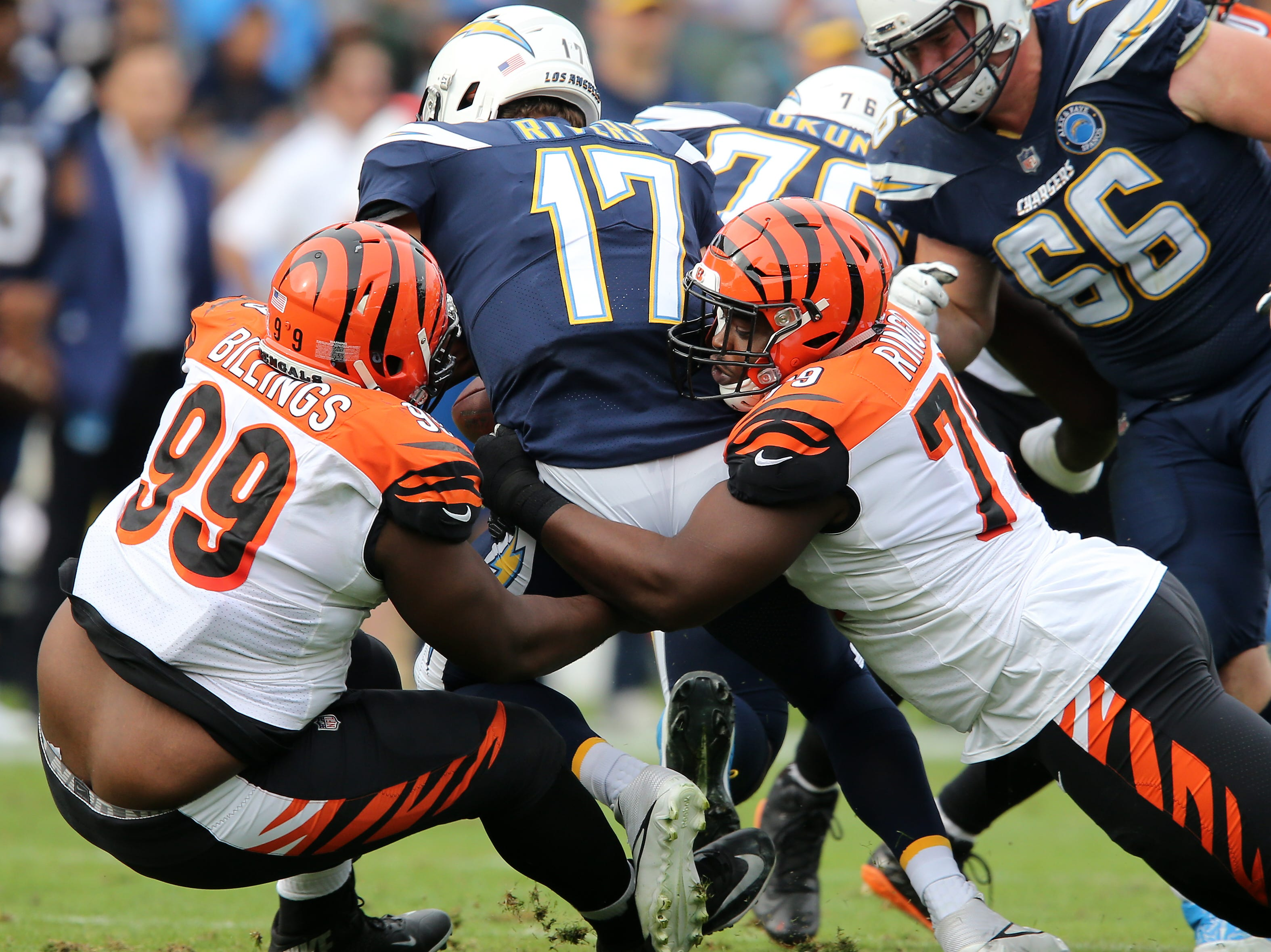 Cincinnati Bengals defensive end Christian Ringo (79) and Cincinnati Bengals defensive tackle Andrew Billings (99) sack Los Angeles Chargers quarterback Philip Rivers (17) in the first quarter of a Week 14 NFL football game, Sunday, Dec. 9, 2018, at StubHub Center in Carson, California.