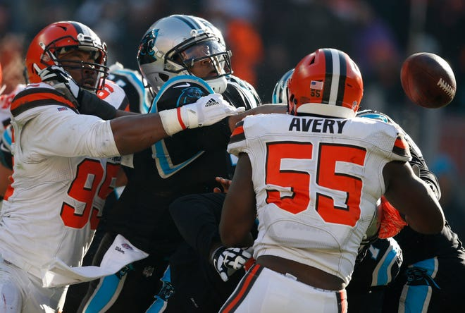 Cleveland Browns defensive end Myles Garrett (95) knocks the ball loose from Carolina Panthers quarterback Cam Newton, center, during the first half of an NFL football game, Sunday, Dec. 9, 2018, in Cleveland.