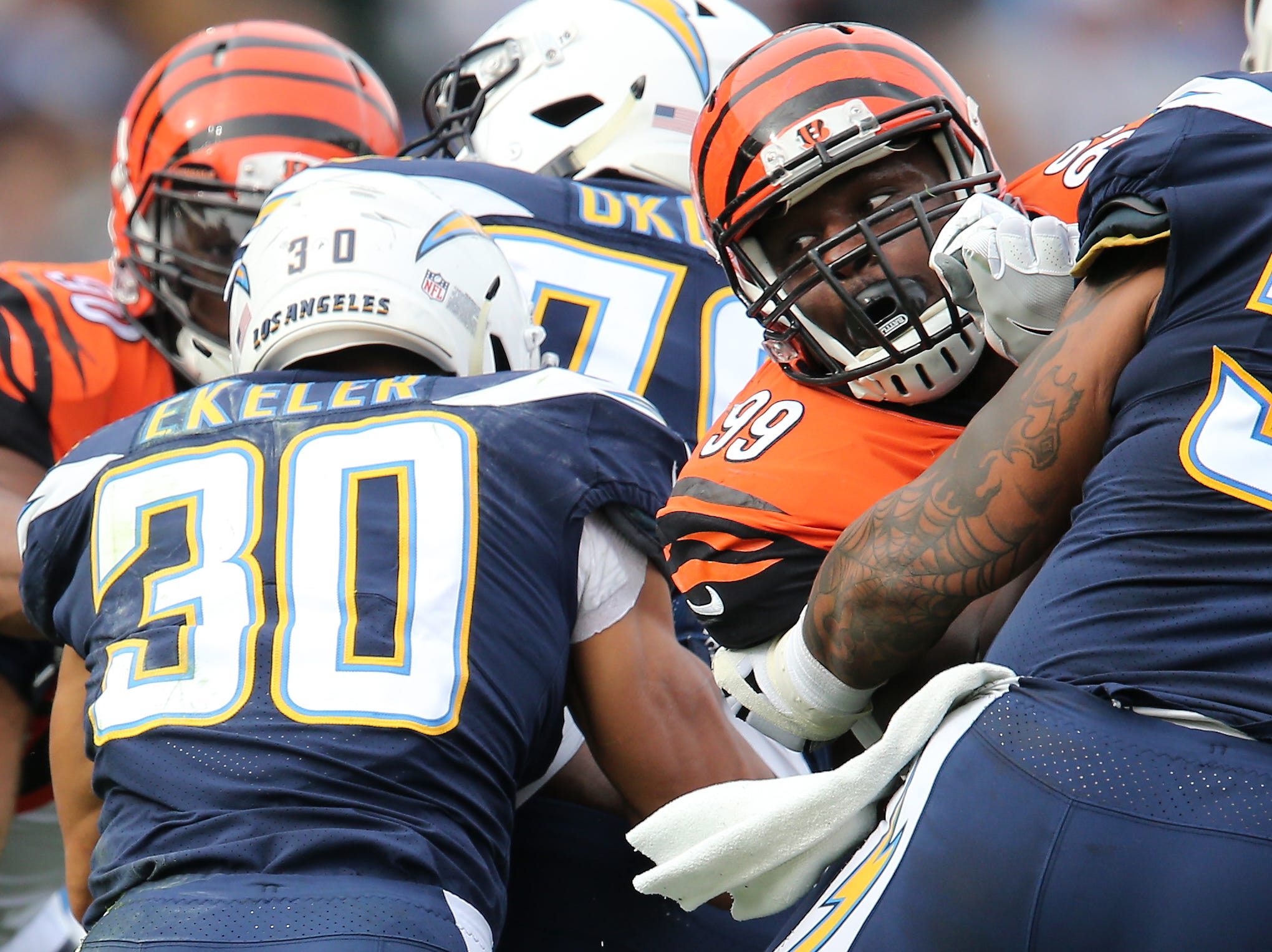 Cincinnati Bengals defensive tackle Andrew Billings (99) looks back to tackle Los Angeles Chargers running back Austin Ekeler (30) in the first quarter of a Week 14 NFL football game, Sunday, Dec. 9, 2018, at StubHub Center in Carson, California.
