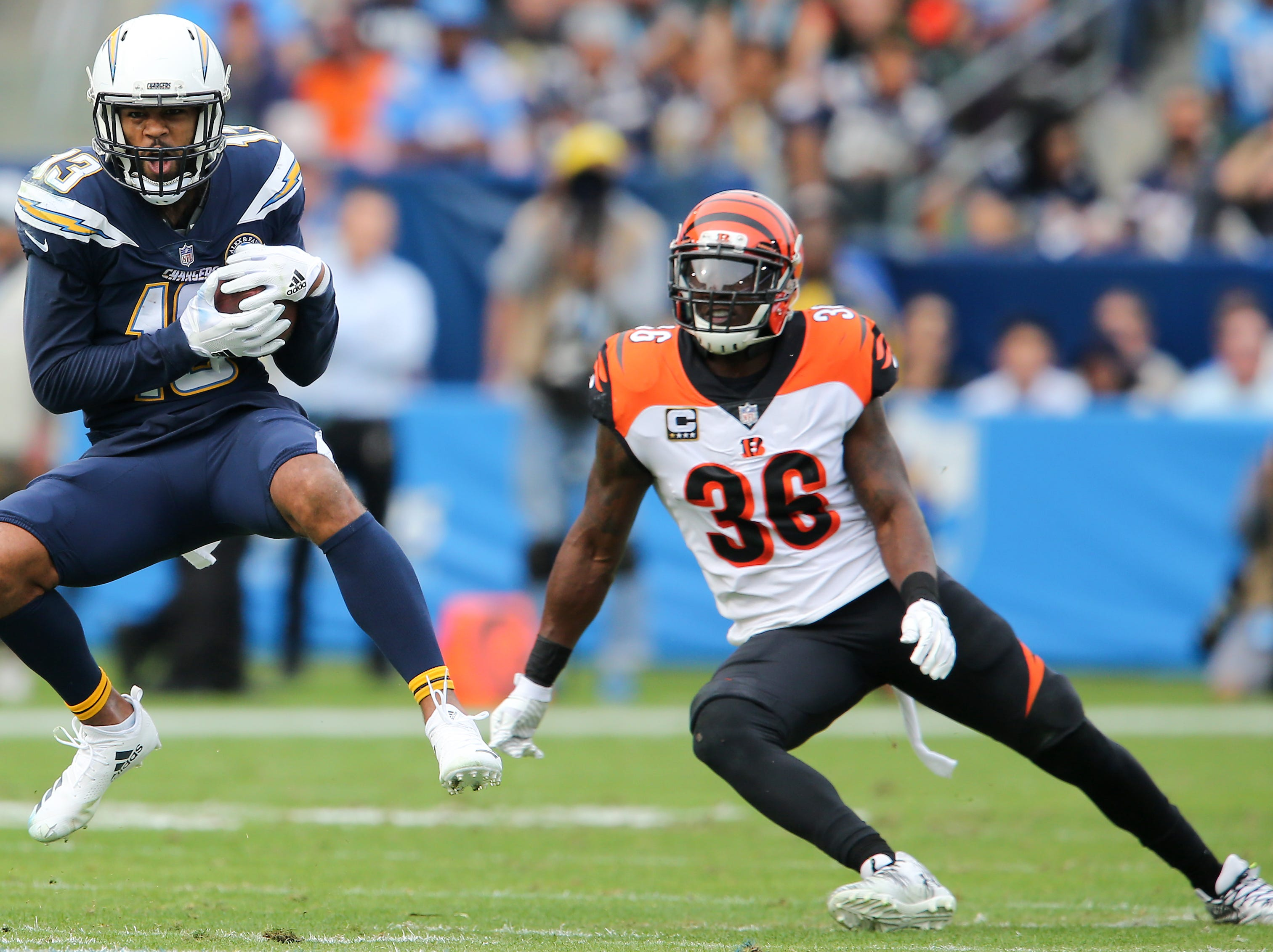Los Angeles Chargers wide receiver Keenan Allen (13) completes a catch as Cincinnati Bengals strong safety Shawn Williams (36) defends in the first quarter of a Week 14 NFL football game, Sunday, Dec. 9, 2018, at StubHub Center in Carson, California.