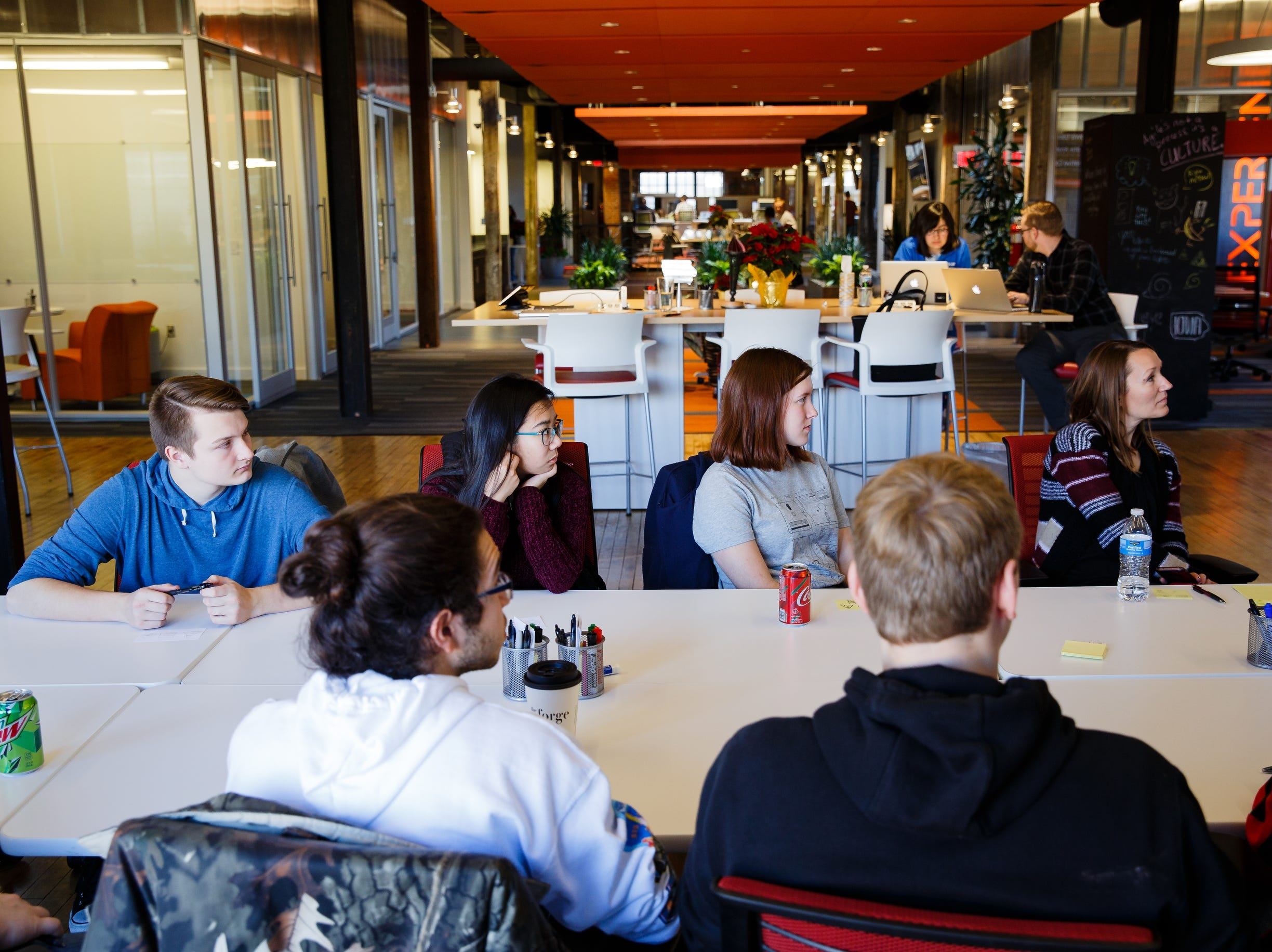 Students from Jefferson listen to Abs King, an Experience Architect at Pillar during a visit Pillar Technologies' Forge on Thursday, Dec. 6, 2018, in Des Moines. The students were learning about tech jobs at the company who is bring a Forge to Jefferson.