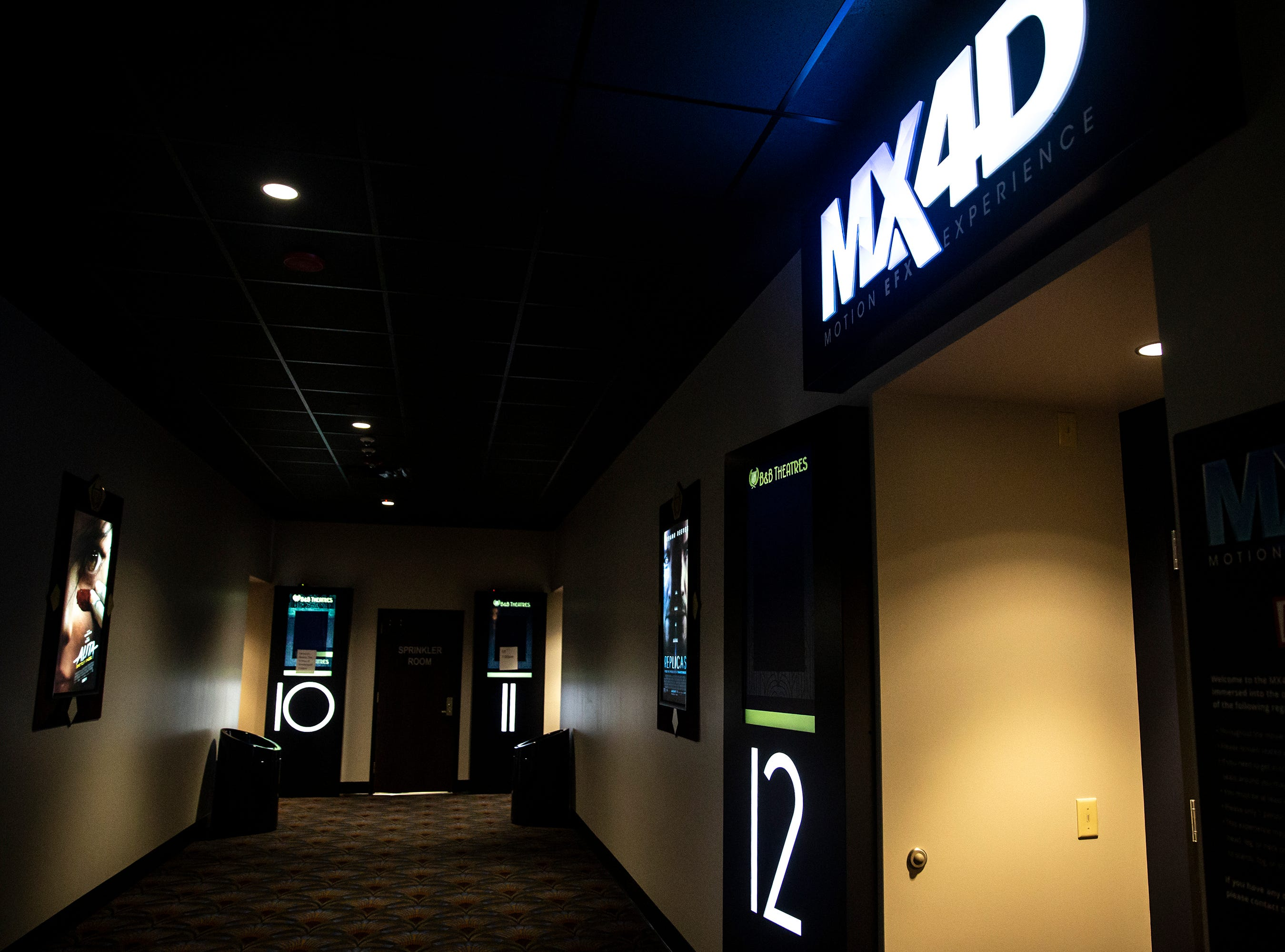 The MX4D theater at B & B Ankeny 12 & B-Roll Bowling has seats that move and effects that mimic the weather, on Sunday, Dec. 9, 2018, in Ankeny.