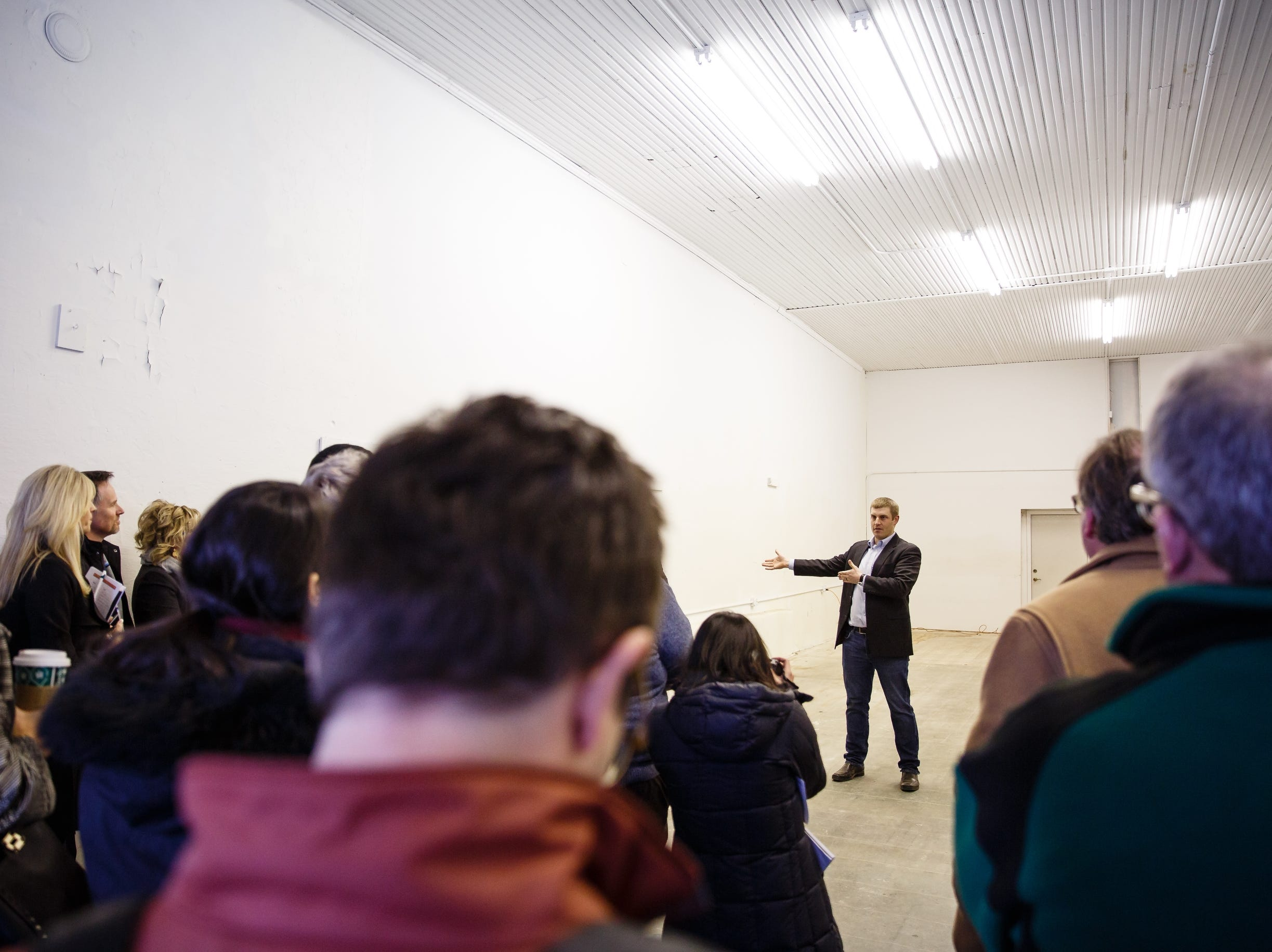 Mechanical engineer Chris Deal talks to a crowd, including Silicon Valley leaders who came to see the building that will eventually house Pillar Technology on Saturday, Dec. 8, 2018, in Jefferson.