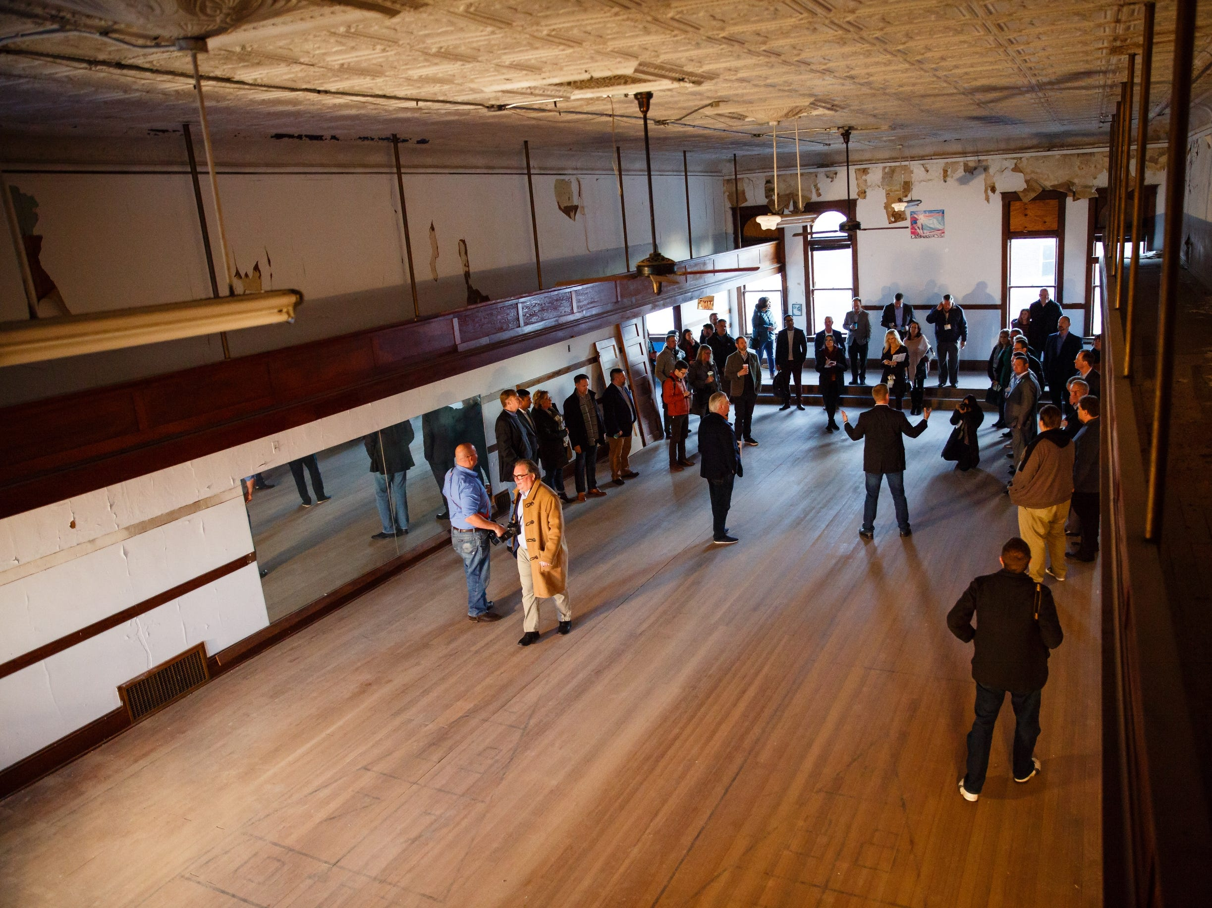 About a dozen Silicon Valley and more local leaders tour the building that will eventually house Pillar Technology's Jefferson Forge on Saturday, Dec. 8, 2018.