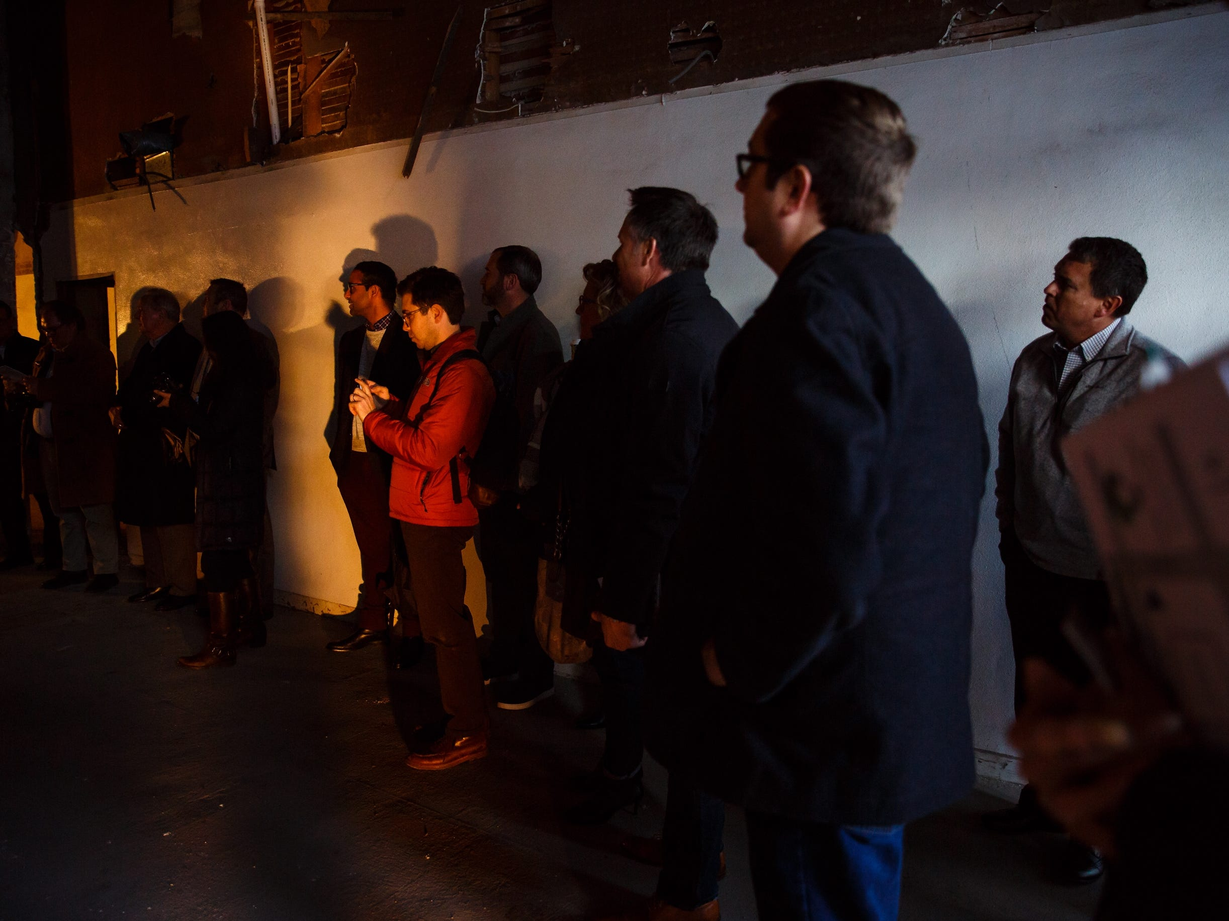 A crowd listens as Mechanical engineer Chris Deal talks to a crowd, including Silicon Valley leaders who came to see the building that will eventually house Pillar Technology on Saturday, Dec. 8, 2018, in Jefferson.