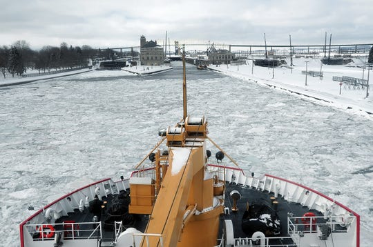 In this March 20, 2014, photo supplied by the United States Coast Guard, Coast Guard Cutter Mackinaw maneuvers through ice on the St. Marys River near the Soo Locks in Sault Ste. Marie, Mich.