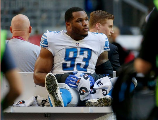 Detroit Lions defensive end Da'Shawn Hand leaves the field after an injury against the Arizona Cardinals during the first half Sunday, Dec. 9, 2018, in Glendale, Ariz.