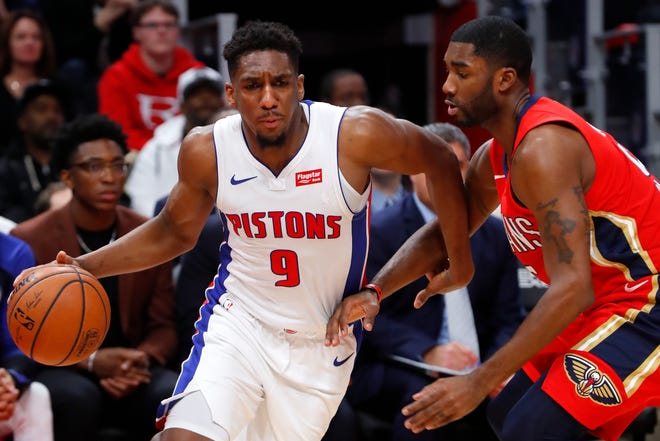 Detroit Pistons guard Langston Galloway drives against New Orleans Pelicans guard E'Twaun Moore in the first half in Detroit, Sunday, Dec. 9, 2018.