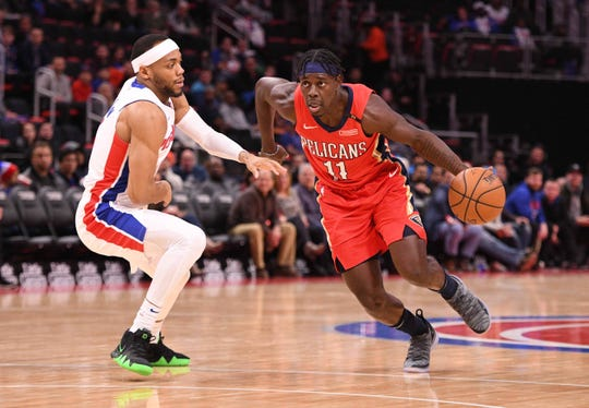 Pelicans guard Jrue Holiday drives against Pistons guard Bruce Brown on Dec. 9. 2018.