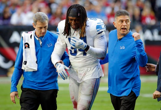 Detroit Lions defensive end Ziggy Ansah is helped off the field by trainers, after a right shoulder injury against the Arizona Cardinals in the first half Sunday, Dec. 9, 2018, in Glendale, Ariz.