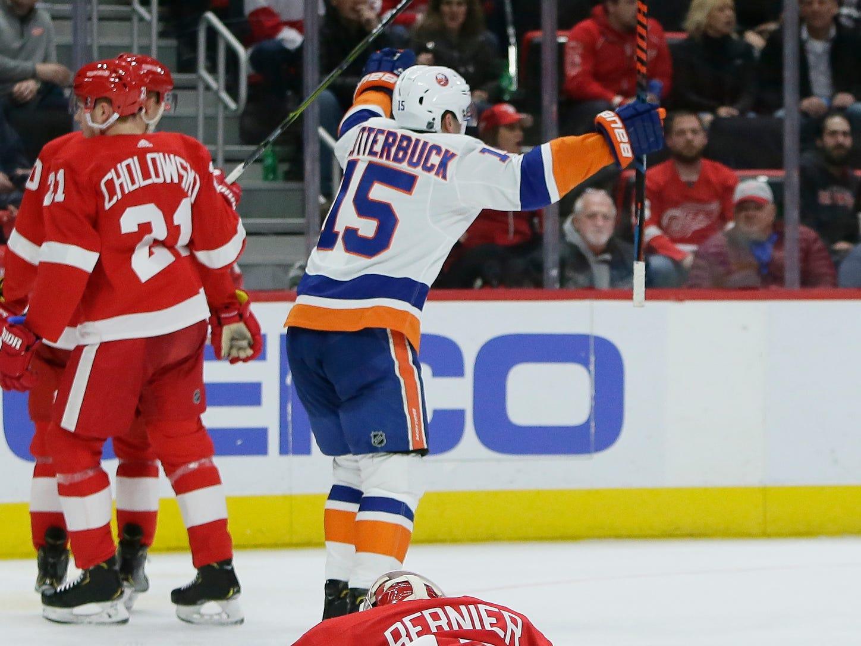 New York Islanders right wing Cal Clutterbuck (15) celebrates a goal by left wing Matt Martin shot past Detroit Red Wings goaltender Jonathan Bernier, bottom, during the third period.