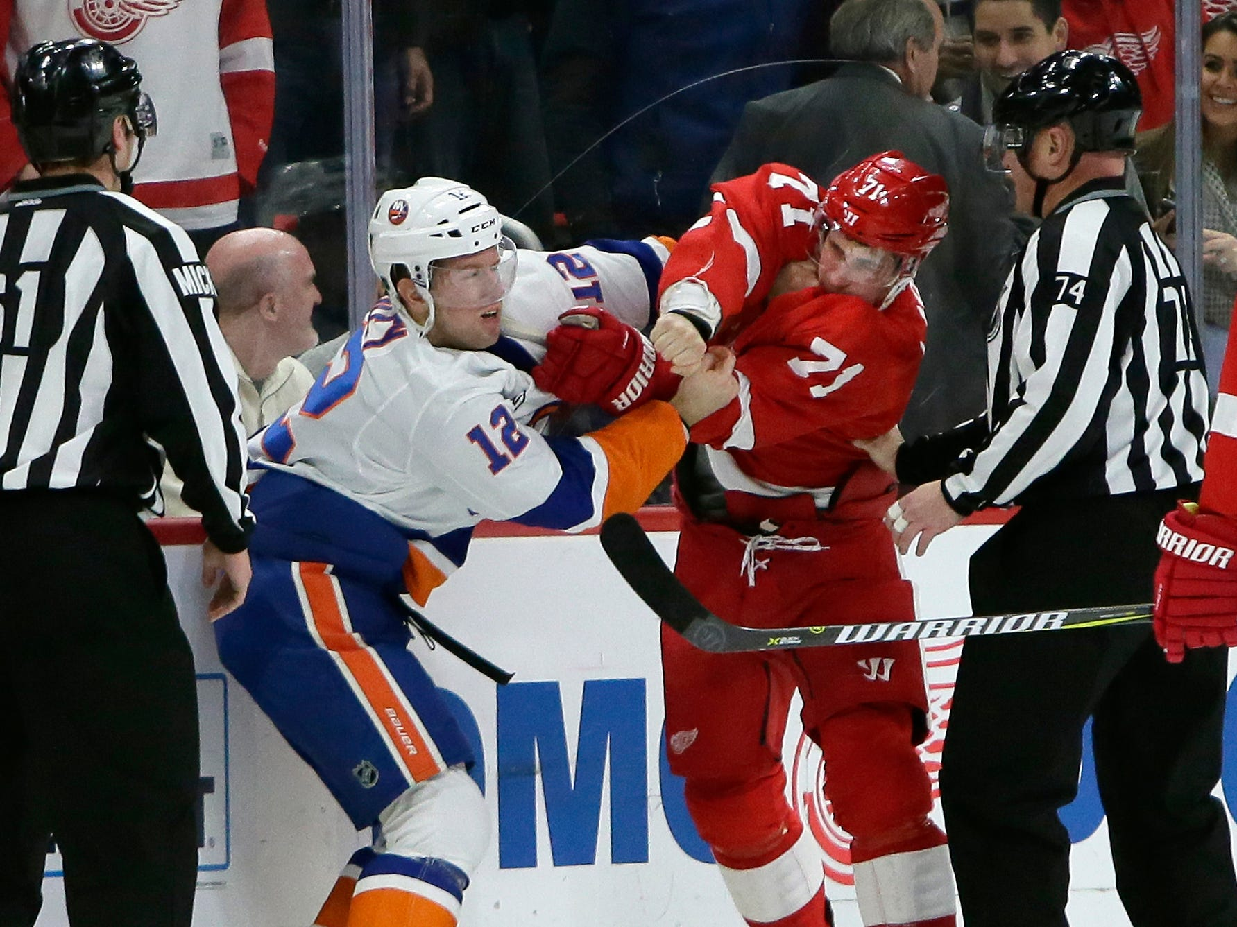 Islanders right wing Josh Bailey (12) fights with Red Wings center Dylan Larkin (71) during the first period.