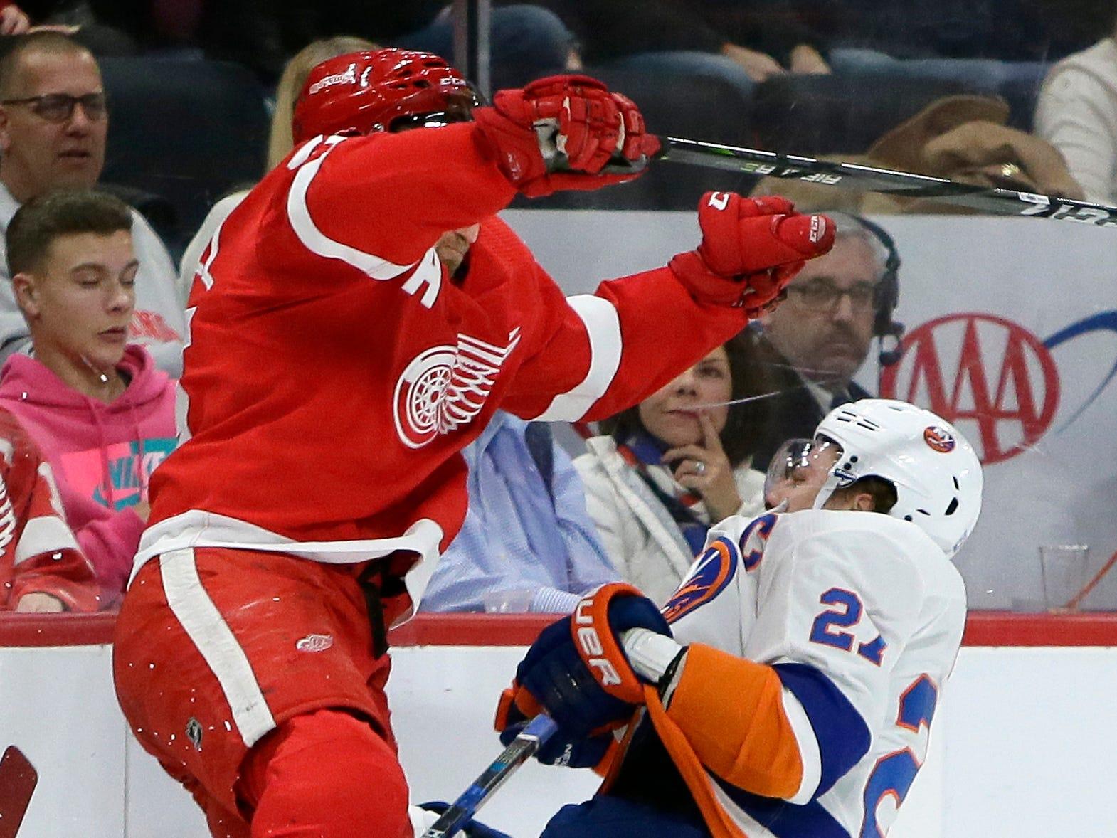 Detroit Red Wings defenseman Niklas Kronwall (55) checks New York Islanders left wing Anders Lee (27) during the first period.