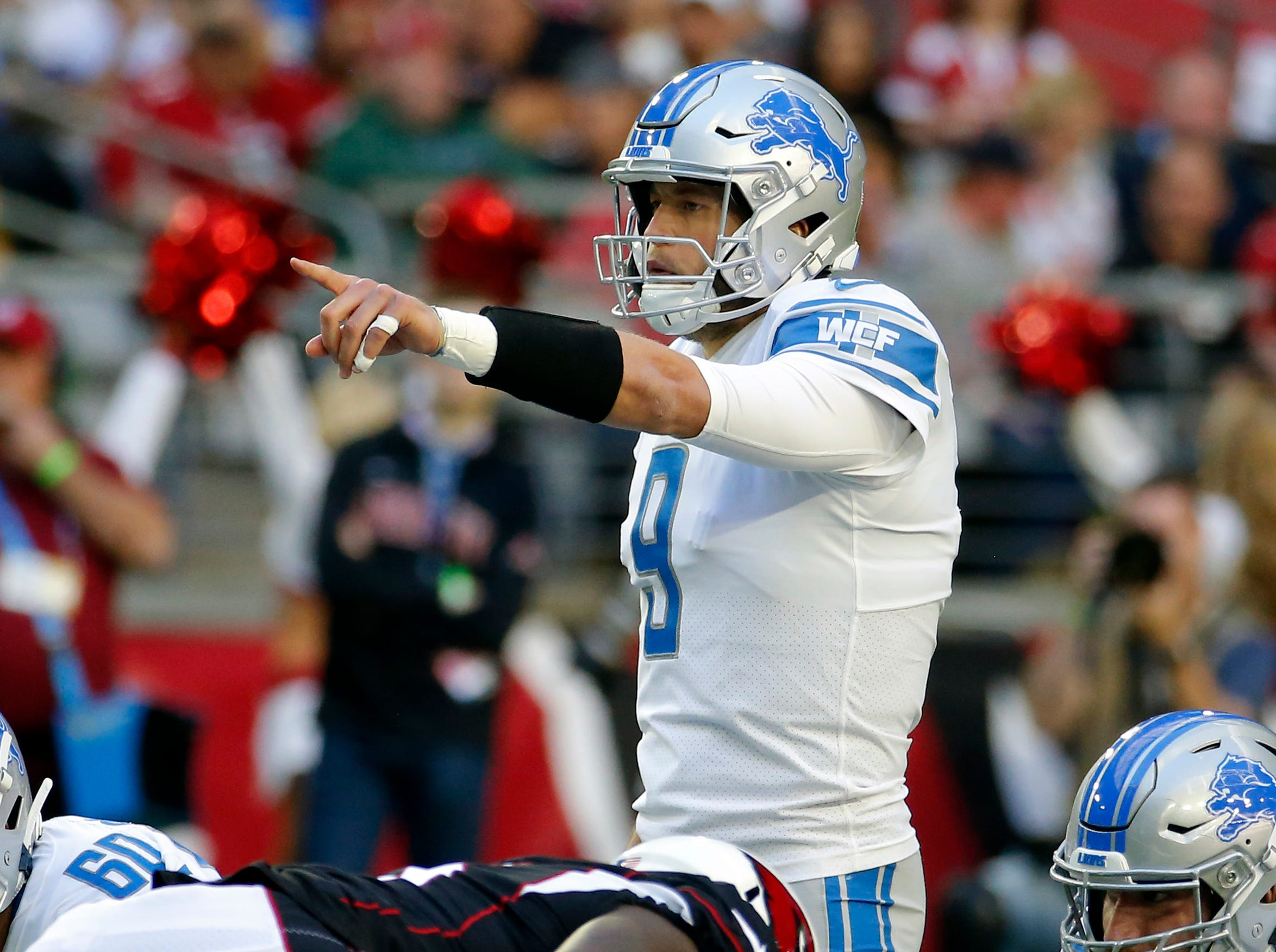 Detroit Lions quarterback Matthew Stafford (9) makes a call against the Arizona Cardinals during the first half.