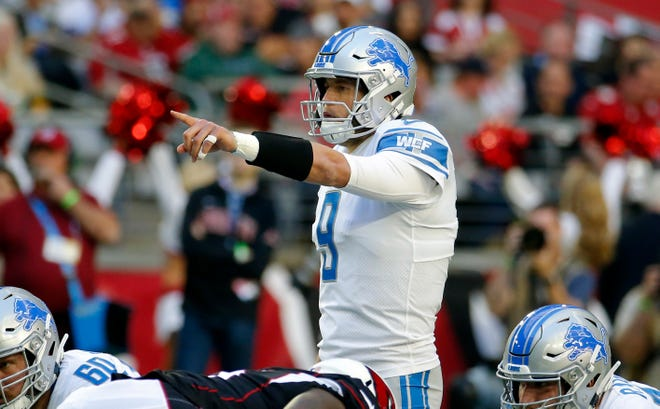 Detroit Lions quarterback Matthew Stafford makes a call against the Arizona Cardinals during the first half.