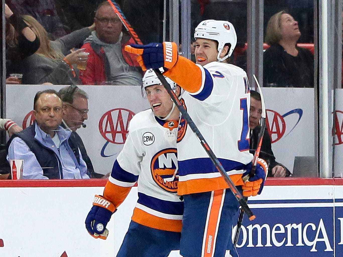 New York Islanders left wing Matt Martin, right, celebrates his winning goal against the Detroit Red Wings with center Casey Cizikas during the third period.
