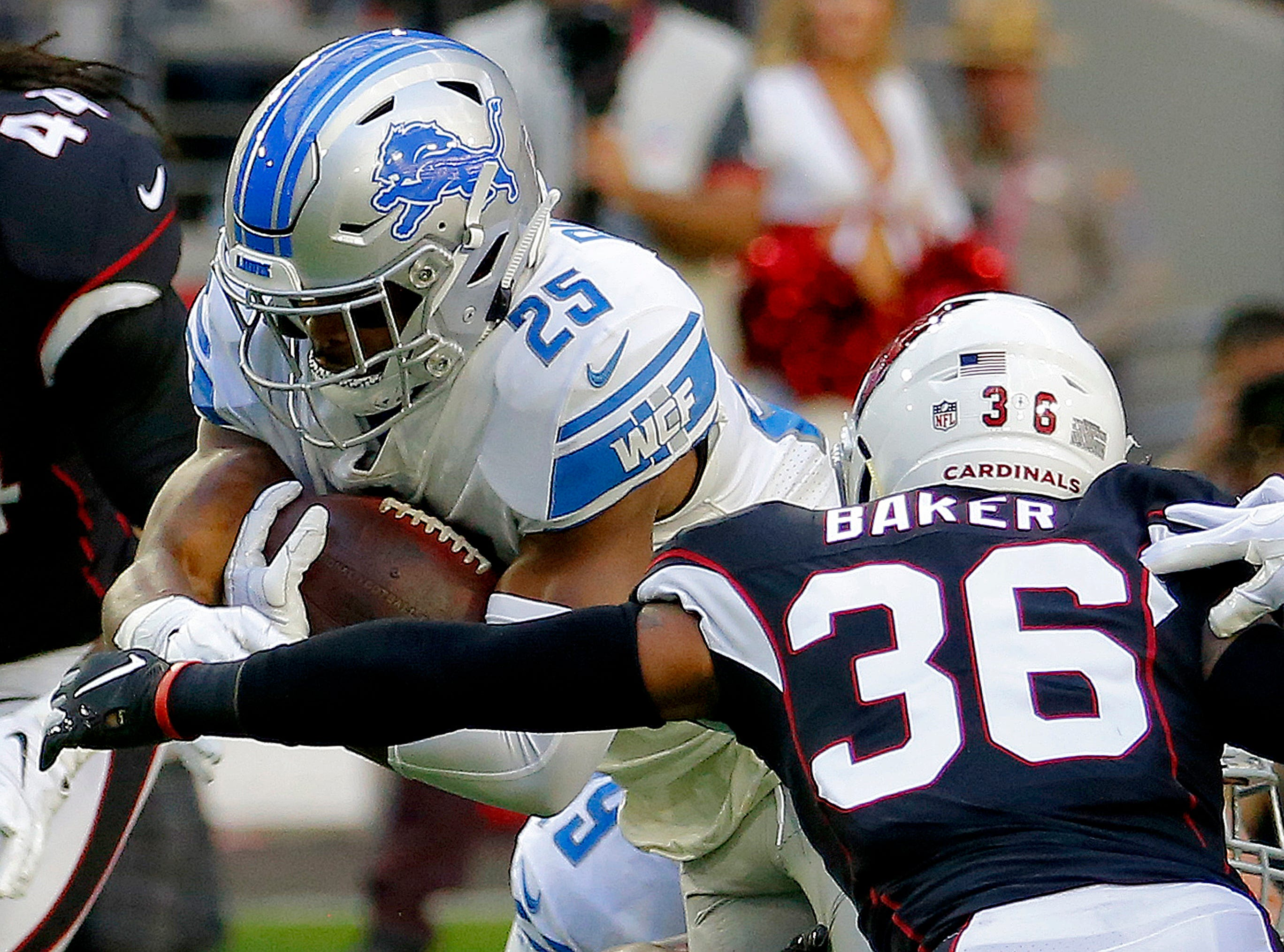 Detroit Lions running back Theo Riddick (25) runs as Arizona Cardinals strong safety Budda Baker (36) makes the stop during the first half of NFL football game, Sunday, Dec. 9, 2018, in Glendale, Ariz.