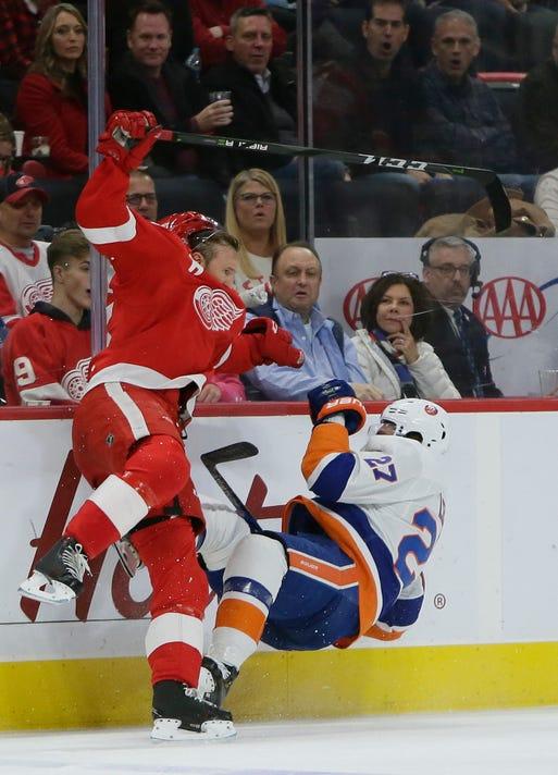 15be2adb620 Detroit Red Wings defenseman Niklas Kronwall checks New York Islanders left  wing Anders Lee during the first period on Saturday night.