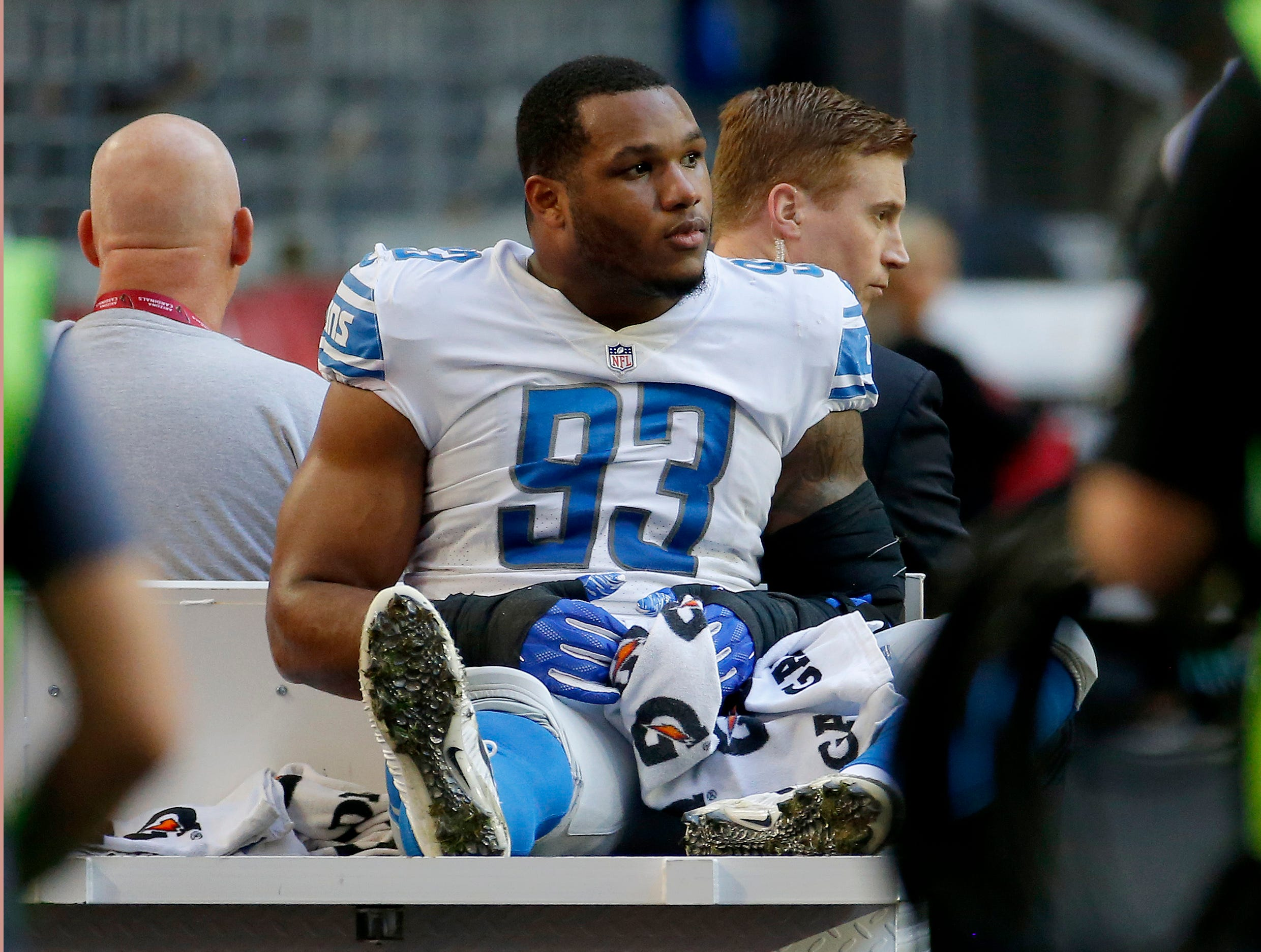 Detroit Lions defensive end Da'Shawn Hand (93) leaves the field after an injury against the Arizona Cardinals during the first half.