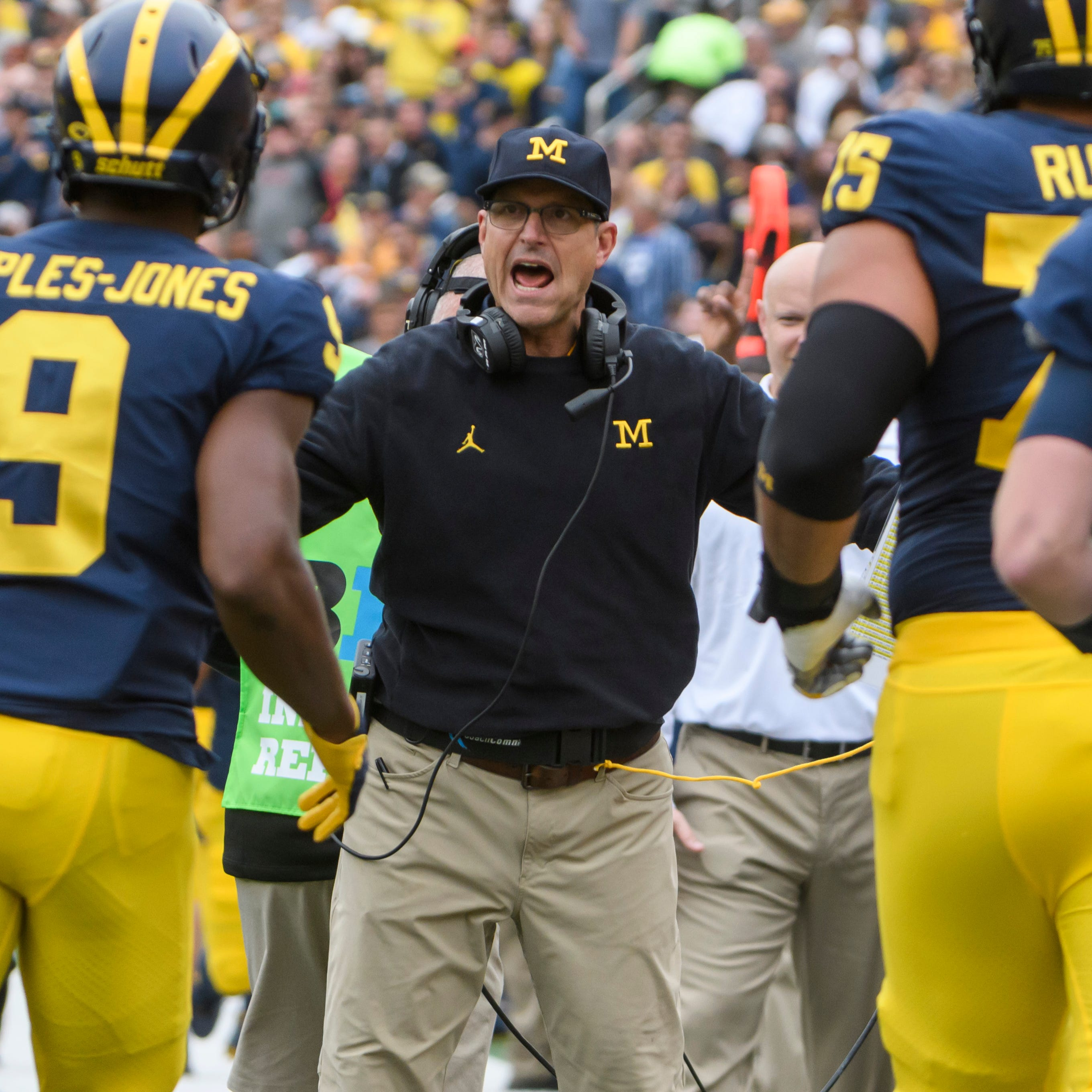 Michigan's Jim Harbaugh: 'I'm not going anywhere'