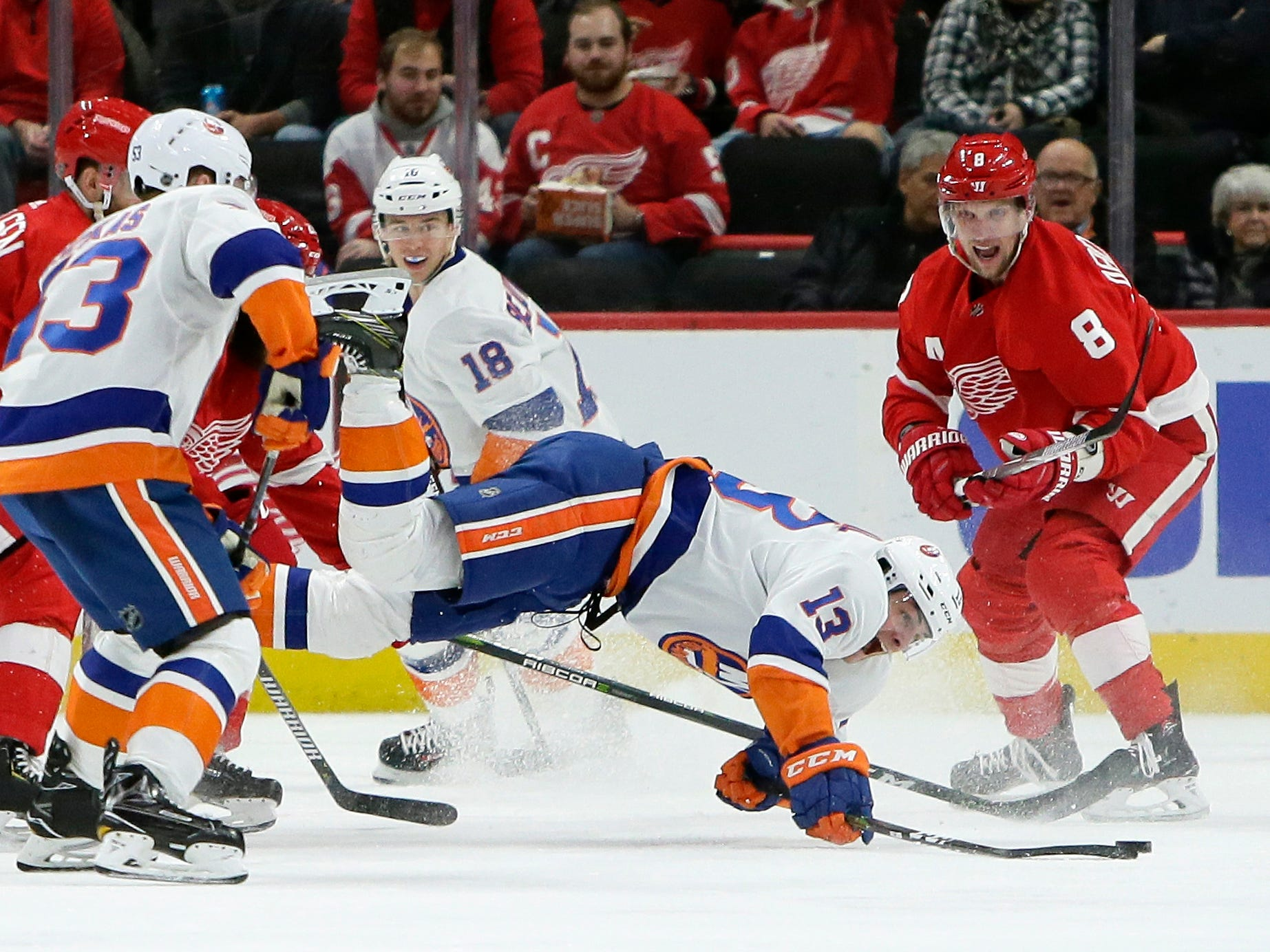 New York Islanders center Mathew Barzal (13) gets tripped up during the second period.