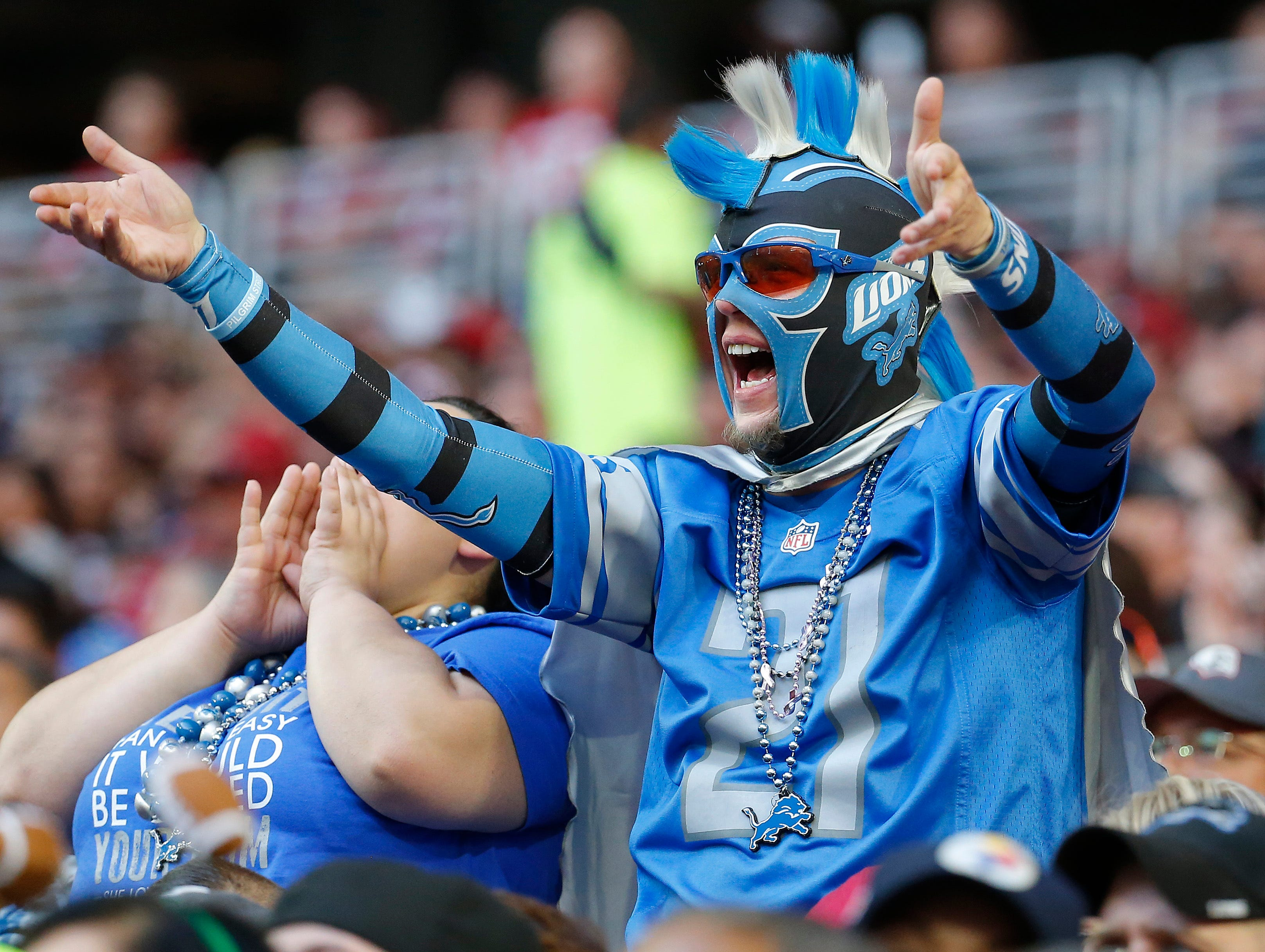 A Detroit Lions fan cheers against the Arizona Cardinals during the first half.