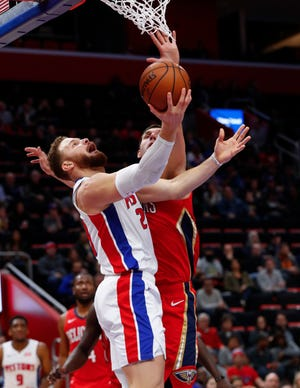 Detroit Pistons forward Blake Griffin  drives on New Orleans Pelicans forward Nikola Mirotic.