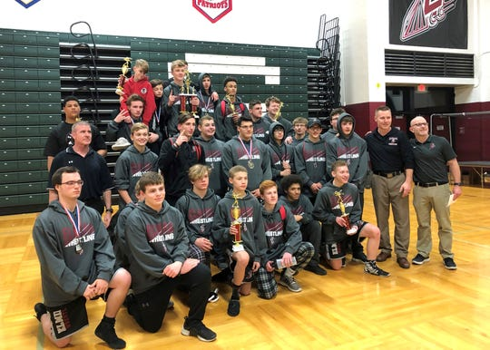 The Elmira wrestling team poses for a photo after taking the title at the Dave Buck Memorial Wrestling Tournament on Dec. 8, 2018 at Elmira High School.