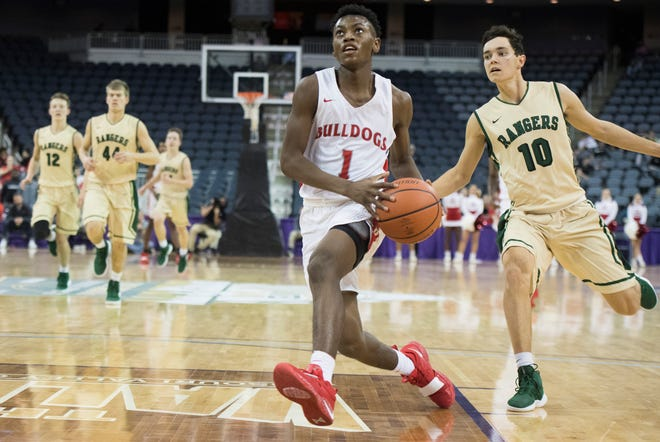 Bosse's Ty'Ran Funches (1) looks up at the basket before taking a shot during the Bosse vs Forest Park game of the River City Showcase at the Ford Center Saturday, Dec. 8, 2018.
