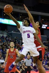 University of Evansville's Shamar Givance (5) advances to the net during the first half against the Ball State University Cardinals at Ford Center in Evansville, Ind., Sunday, Dec. 9, 2018. The Purple Aces defeated the Cardinals 89-77.