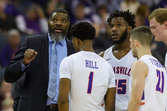 University of Evansville Head Coach Walter McCarty talks to his team during a timeout in the second half against the Ball State University Cardinals at Ford Center in Evansville, Ind., Sunday, Dec. 9, 2018. The Purple Aces defeated the Cardinals 89-77.