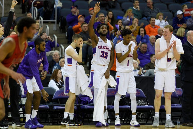 University of Evansville's John Hall (35) reacts to a UE three-pointer against the Ball State University Cardinals in the second half at Ford Center in Evansville, Ind., Sunday, Dec. 9, 2018. The Purple Aces defeated the Cardinals 89-77.