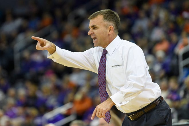 Ball State Head Coach James Whitford argues with a referee call during the first half against the University of Evansville Purple Aces at Ford Center in Evansville, Ind., Sunday, Dec. 9, 2018. The Purple Aces defeated the Cardinals 89-77.