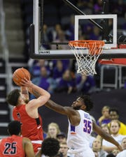 University of Evansville's John Hall (35) blocks Ball State's Tayler Persons (2) from making a shot during the second half at Ford Center in Evansville, Ind., Sunday, Dec. 9, 2018. The Purple Aces defeated the Cardinals 89-77.