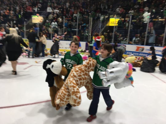 Youths help during the pick up of stuffed animals for the Florida Everblades' Teddy Bear Toss.