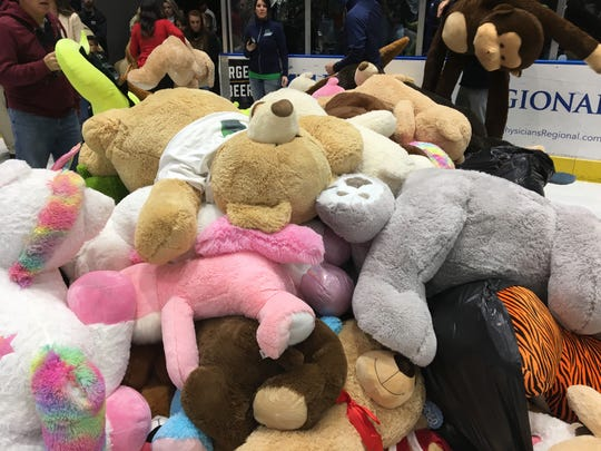 Thousands of stuffed animals are waiting to be picked up during the Florida Everblades Teddy Bear Toss