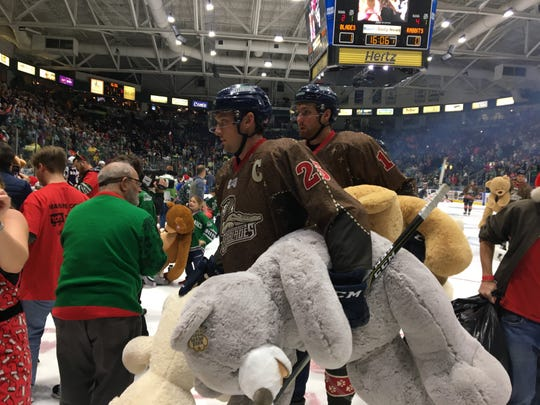 Even members of the Greenville Swamp Rabbits hockey team get in the spirit of helping to collect stuffed animals from the Florida Everblades' Teddy Bear Toss