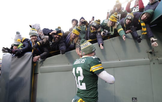 Green Bay Packers quarterback Aaron Rodgers (12) celebrates with fans after defeating the Atlanta Falcons 34-20 Sunday, December 9, 2018, at Lambeau Field in Green Bay, Wis.  Dan Powers/USA TODAY NETWORK-Wisconsin