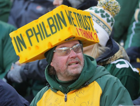 A fan wear a cheesehead offering qualified support to interim Green Bay Packers head coach Joe Philbin during the first quarter of their game against the Atlanta Falcons Sunday, December 9, 2018 at Lambeau Field in Green Bay, Wis.  MARK HOFFMAN/MILWAUKEE JOURNAL SENTINEL