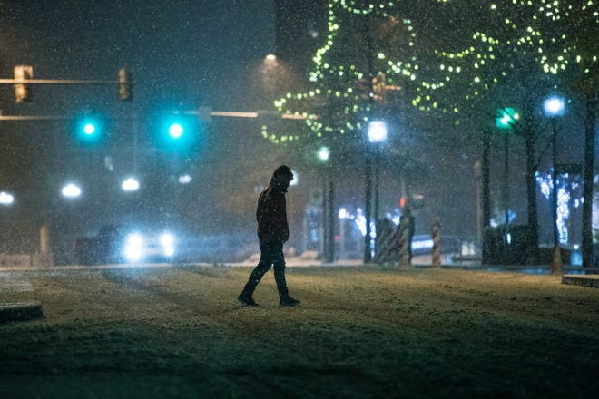Snow begins to fall in Greenville overnight on Sunday, Dec. 9, 2018.