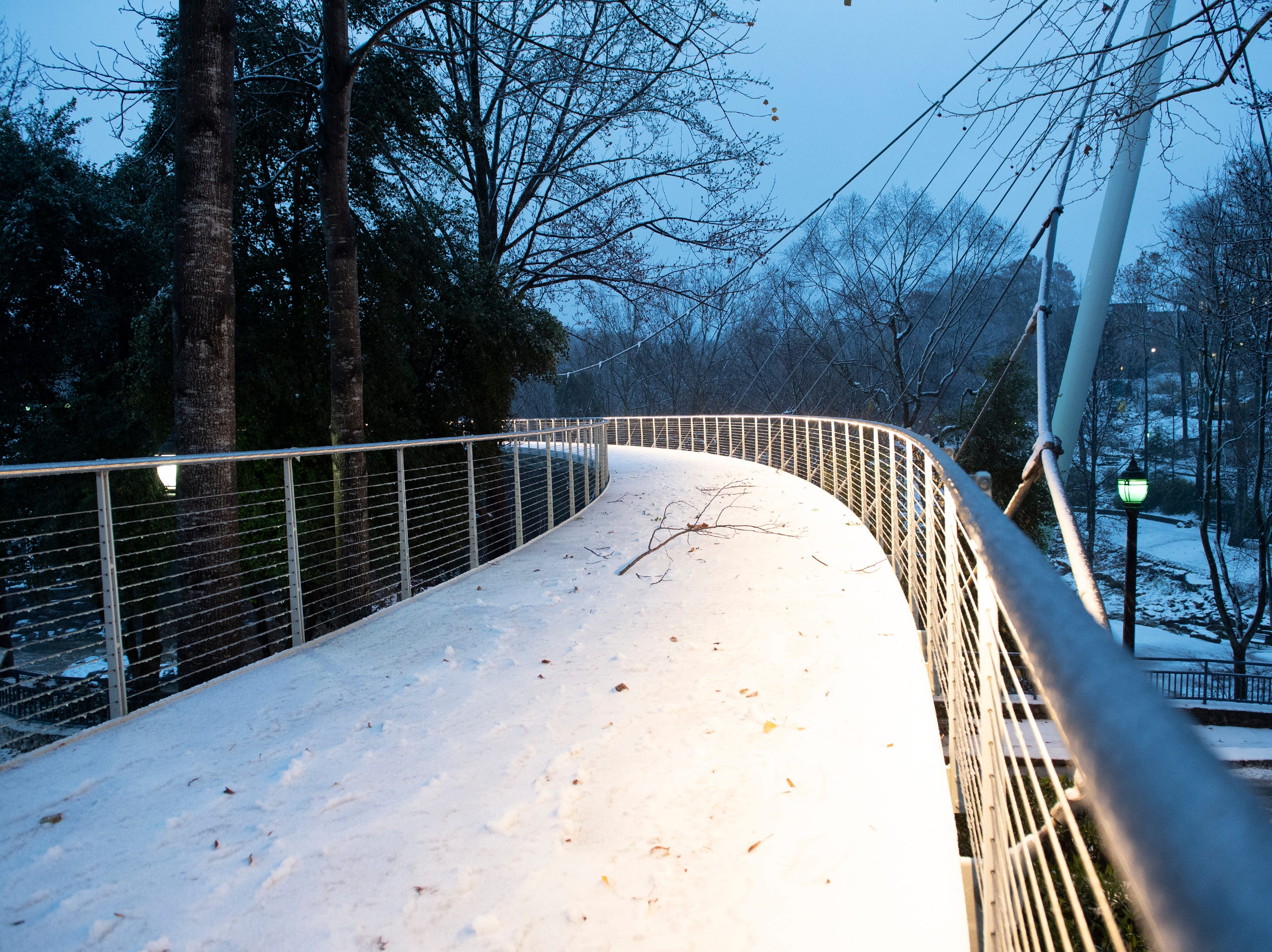 Snow covers a bridge at Falls Park on the Reddy as an icy mix falls Sunday, Dec. 09, 2018.