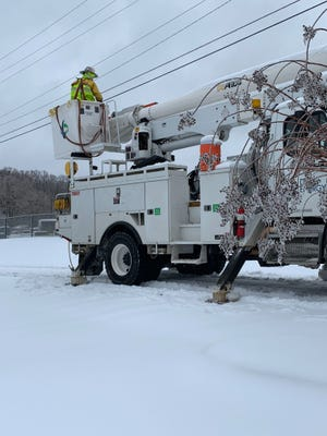 Utility crews near Mountain Creek Church on Sunday, Dec. 9, 2018, said it'll take 1-2 days to restore power in the area.