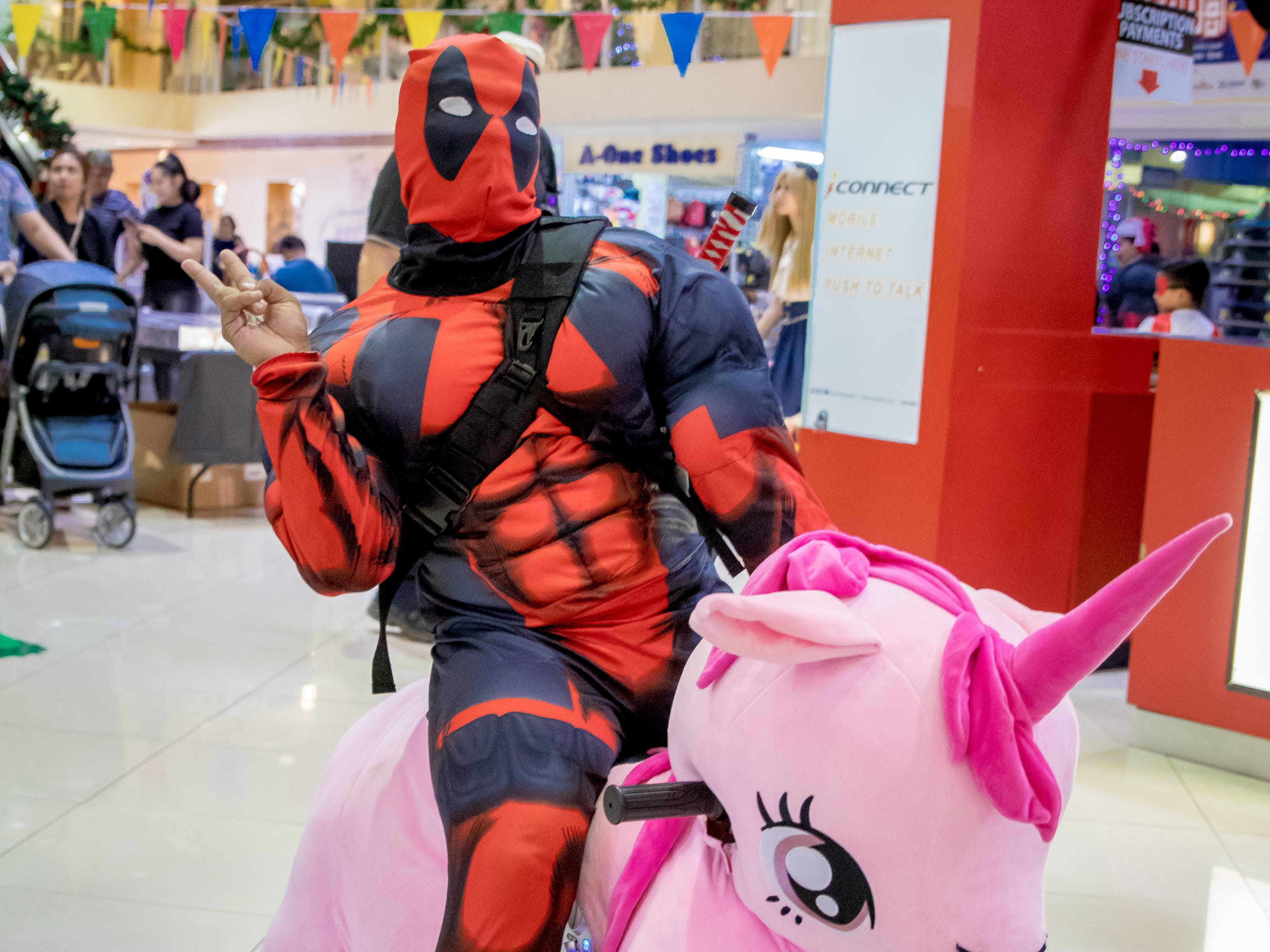 Cosplayers take a ride on an amusement ride during the Herocon event held at Agana Shopping Center on Dec. 9.